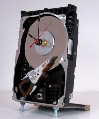 Hard drive desk clock is a hard disk drive converted into a working clock