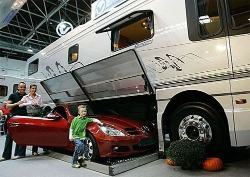 Luxury rv with built in garage for Rv with garage