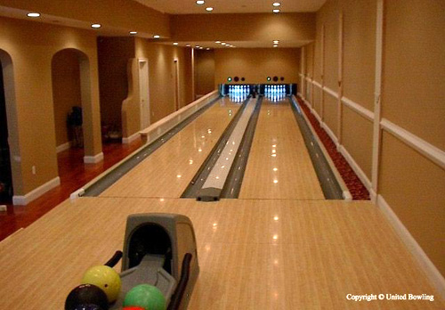 Rich persons personal home indoor bowling alley.