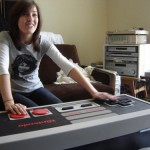 The NES Coffee Table stores games, controls console