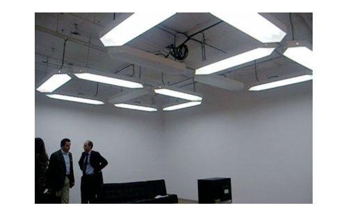 Overhead clock doubles as light fixture