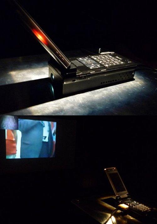 Docomo shows off pocket cinema cell phone projector