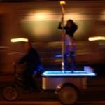 Bicycle Rickshaw with stripper pole leaves a trail of dollar bills