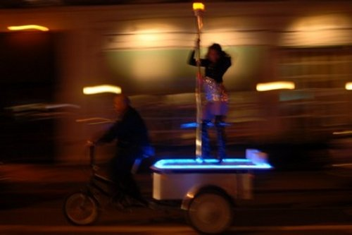 Bicycle Rickshaw with stripper pole leaves a trail of dollar bills