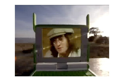 John Lennon pushes OLPC from beyond