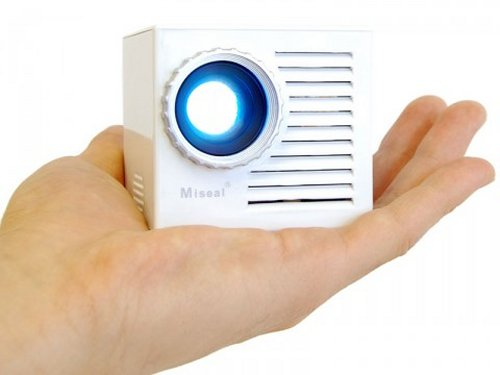 Miniature cube projector with docking speaker