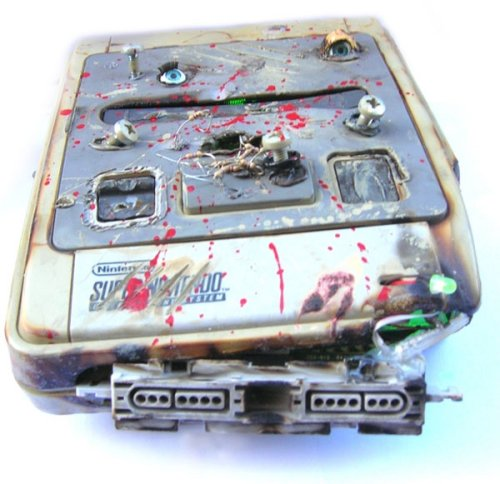 http://technabob.com/blog/2009/07/14/game-over-snes-casemod-from-a-clearly-disturbed-mind/